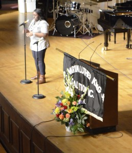 """Tayshona Holliday performing her piece, """"Finally"""" to a crowded Music Hall."""